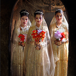 In Yemen, where marriage can resemble a business transaction, sisters Galiyaah, 13, and Sidaba (11), marry the brothers of their cousin, Khawlah (12), who wed the sisters' uncle.