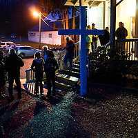 People leave the Oso Community Chapel in Oso, Washington after a prayer meeting for victims of the mudslide March 26, 2014. Search teams picked through mud-caked debris for a fifth day on Wednesday looking for scores of people still missing in a deadly Washington state landslide, as officials reported finding more bodies while acknowledging that some victims' remains may never be recovered. REUTERS/Rick Wilking(UNITED STATES)