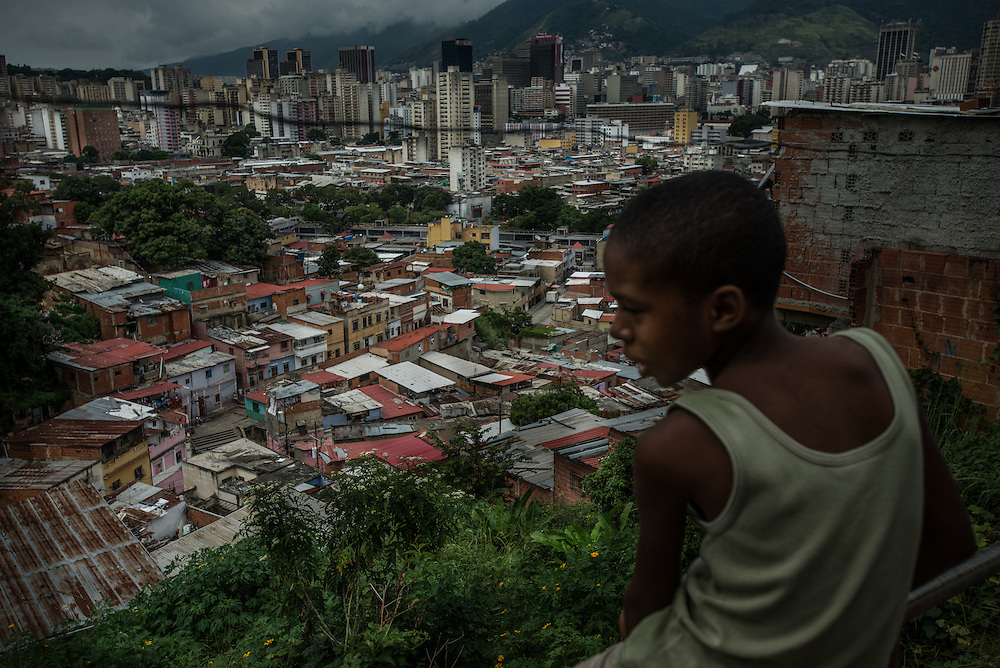 CARACAS, VENEZUELA - NOVEMBER 12, 2016:  San Augustín slum is one of the most dangerous areas of the capital. A severe economic crisis in Venezuela, caused by the drop in oil prices and years of economic mismanagement under a Socialist government, has lead to an alarming rise in crime and insecurity in the country.  Hyperinflation has left both the working class and professional class of workers with salaries that cannot purchase enough food to feed their families for the month.  Many people are turning to crime to make ends meet.  PHOTO: Meridith Kohut for The New York Times