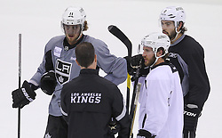 May 29; Newark, NJ, USA; Los Angeles Kings center Anze Kopitar (11), Los Angeles Kings center Mike Richards (10) and Los Angeles Kings defenseman Drew Doughty (8) during Stanley Cup Finals media practice day at the Prudential Center.