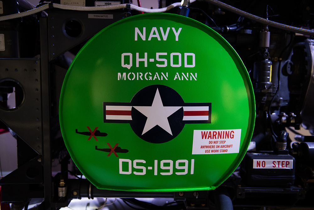 """30206010A - DRONES - A Gyrodyne QH-50 DASH (Drone Anti-Submarine Helicopter), first flown in 1959 and introduced for military use in 1963, sits on display, showing livery for two submarine kills, near the entry of the """"Drones: Is the Sky the Limit?"""" exhibit at the Intrepid Sea, Air, and Space Museum in New York, NY on May 9, 2017."""