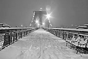 New York City: Broklyn Bridge pedestian walkway in a snowstorm