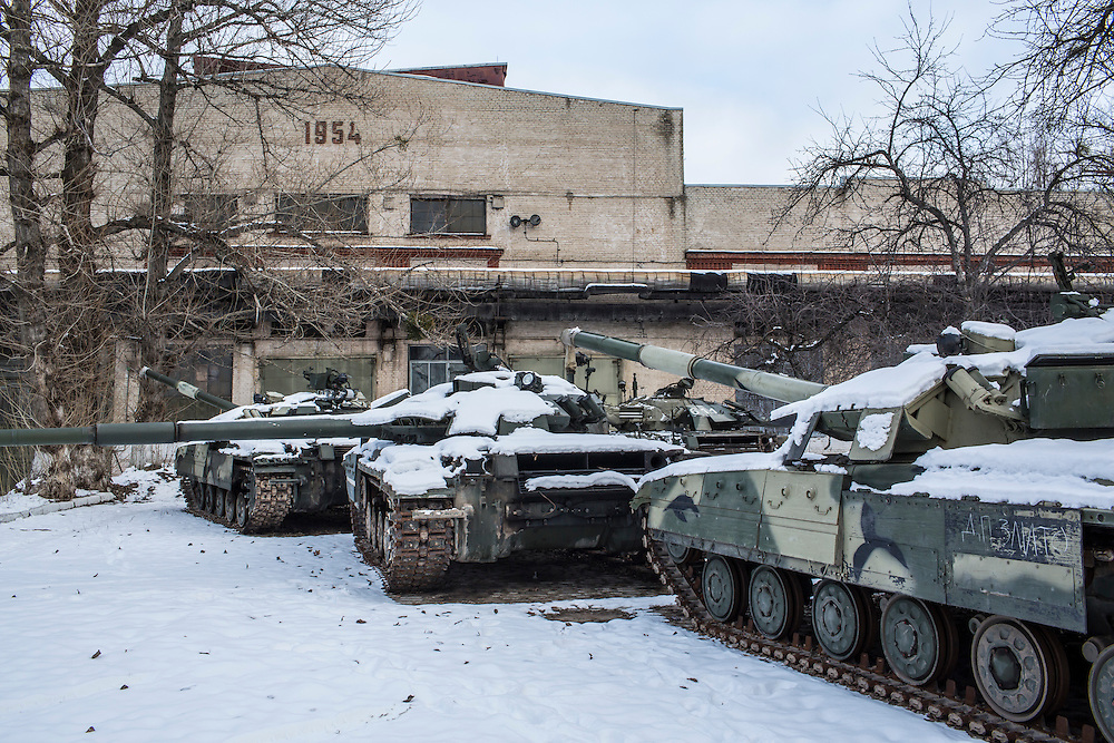 Tanks in need of repair are parked outside at the Malyshev Tank Factory on Wednesday, February 11, 2015 in Kharkiv, Ukraine.