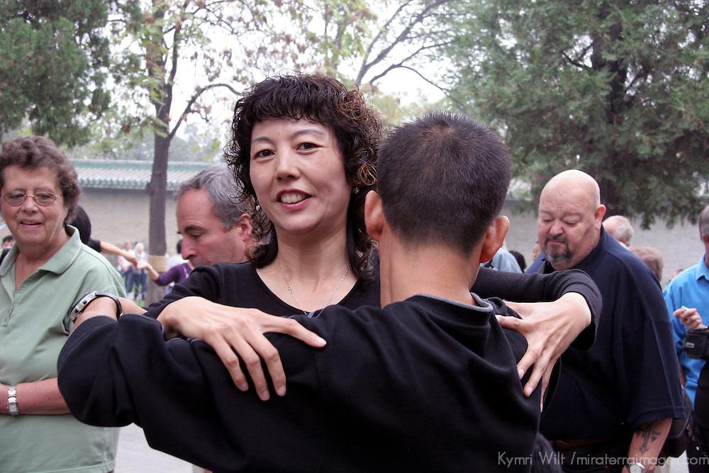 Asia, China, Beijing. Ballroom dancers in Beijing's Temple of Heaven Park.