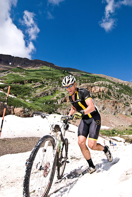 """""""I don't think we're in France anymore Toto."""" Lance Armstrong reminds himself of the disparities between road and mountain competition as he hikes a bike through the 100yd snow plug below Emerald Lake. Racers had to cross this snowfield at 11,000ft twice during Sunday's race."""