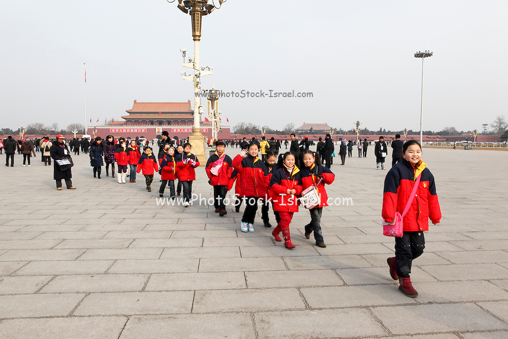 China, Beijing, Tiananmen Square is located in the heart of Beijing, at the entrance to the Forbidden city A group of Chinese children on tour