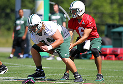 Jun 7, 2012; Florham Park, NJ, USA; New York Jets quarterback Mark Sanchez (6) takes a snap from New York Jets center Nick Mangold (74) during the New York Jets organized team activities at the Atlantic Health Training Center.