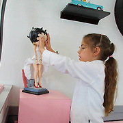 ANNABELLE -- geneseo, Ill, nov. 4 -- Annabelle Costanzo, 7, feels the face of a Betty Boop doll at a McDonalds in Geneseo, Ill., where she and her family stopped for lunch Tuesday enroute to Detroit.  Costanzo, who is blind, is scheduled to have eye surgery Friday at William Beumont Hospital in hopes of gaining her vision.  photo by david peterson