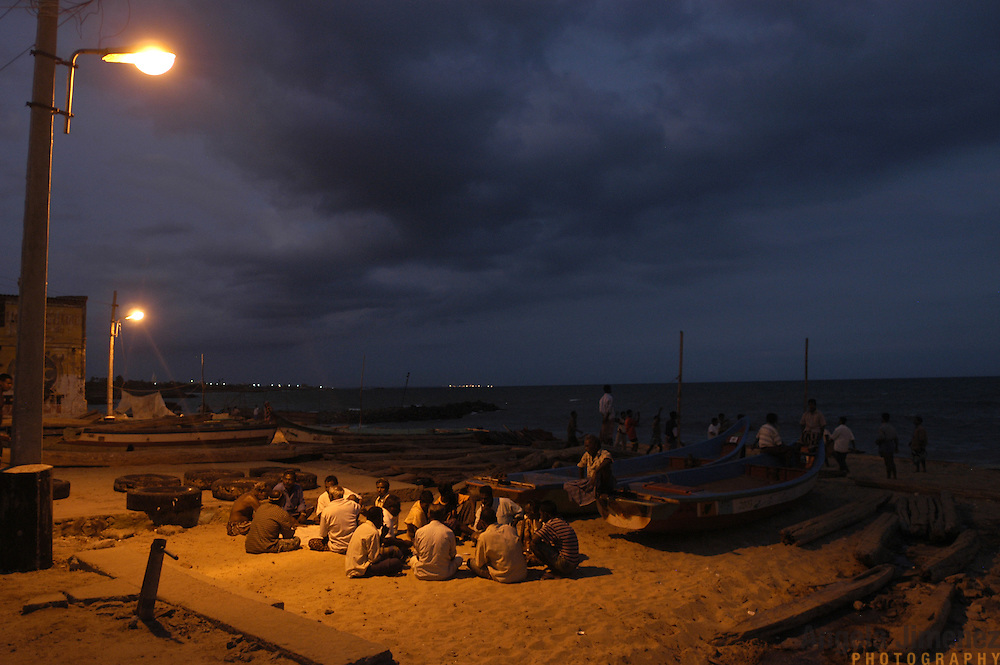 Fishermen socialize on the beach in the fishing village of Nagercoil, in the Kanyakumari district of Tamil Nadu, India on February 1, 2005, after the area was struck by the Indian Ocean Tsunami on December 26, 2004. Generated by an earthquake on the ocean floor, the tsunami devastated the fishing industry along the southeastern coast of India.