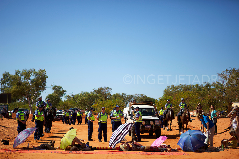 Dozens of protesters, locked themselves onto barrels in today's bid to halt work on Woodside's gas factory project near James Price Point. Goolarabooloo men and women have set up camp on the access track to Woodside's compound and are carving traditional implements such as clapping sticks. Broome, WA