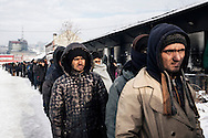 Thousand homeless migrants line up for a meal distribution. They get only one meal per day from an aid organization.