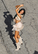 "April 21st 2011. Los Angeles, CA. Non Exclusive. Nicole Scherzinger performs some sexy dance moves on the streets of Downtown LA while filming a music video for her song ""Right There"". The former Pussycat Doll also performed with some other sexy dancers in some scenes. Rapper 50 Cent filmed a cameo appearance in the video earlier in the week. Photo by Eric Ford/ On Location News 818-613-3955  info@onlocationnews.com"