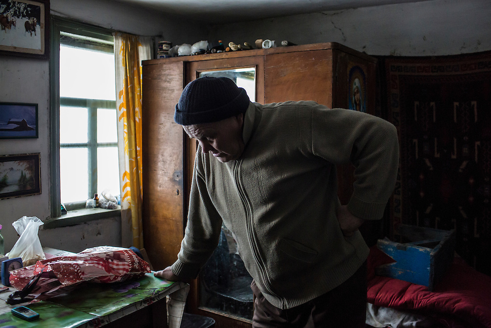 SNEZHNE, UKRAINE - JANUARY 25, 2015: Vladimir Moroz, who used to operate his own small coal mine across the street from his house, stands in his house in Snezhne, Ukraine. The area is well known for its many coal mines, both large operations and small backyard operations. CREDIT: Brendan Hoffman for The New York Times