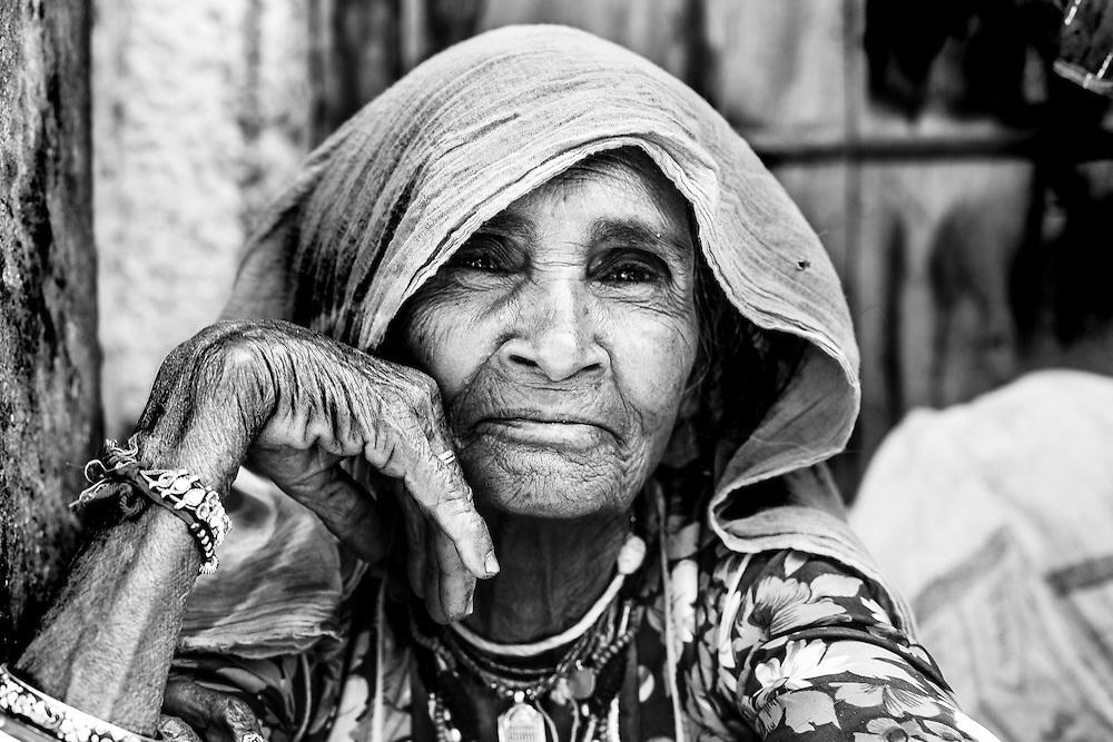 A woman watches the Rama Navami procession, also called Ratha Yatra