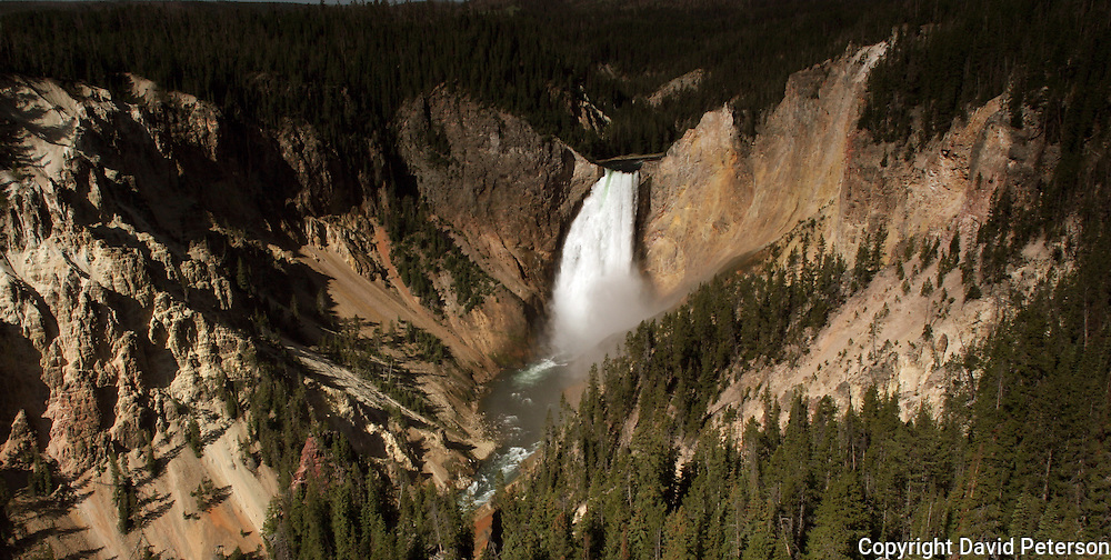 The Lower Falls cascade down to the floor of Yellowstone Canyon at Yellowstone National Park in Wyoming.  The falls, which reach a height of 308, can be seen from many lookout points along the canyon rim.  The water source for the falls is the Yellowstone River.
