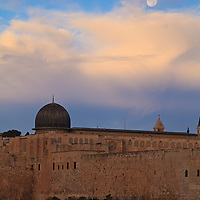 The dome of the Al Aqsa mosque under a setting Moon around sunrise.