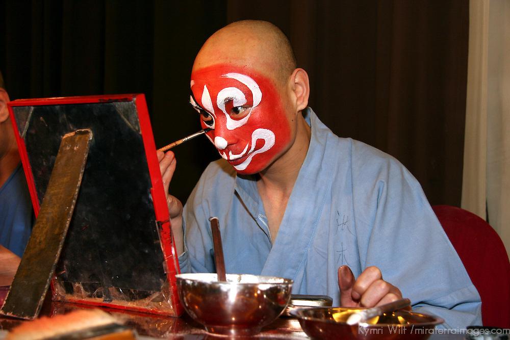 Asia, China, Beijing. Beijing Opera performer applies make up backstage.