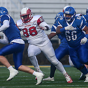 Smyrna defensive linemen Jamier Smith (88) sacks quarterback Drew Fry (8) during the DIAA division one Football Championship game between Top-seeded Middletown (11-0) and second-seeded Smyrna (11-0) Saturday, Dec. 03, 2016 at Delaware Stadium in Newark.