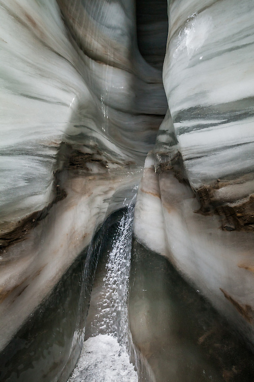 Meltwater stream head cut in an ice cave in Larsbreen, Svalbard.