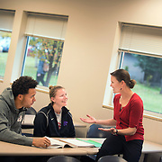 Marketing professor, Peggy Sue Loroz working with students.<br /> <br /> Photo by Rajah Bose