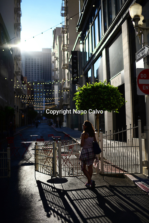 Young woman in commercial street off Union Square, San Francisco.