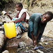 Asefu Reade, 18, collecting water at the water source in Adi Sibhat, Tigray, Ethiopia.