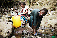 Asefu Reade, 18, collecting water at the water source in Adi Sibhat, Tigray, Ethiopia.