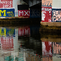 TAMPA, FL  -- Murals depicted various student rowing clubs cover the walls near the Tampa Bay Rowing Club on the University of Tampa campus near the Cass Street Bridge in Tampa, Florida. (Chip Litherland for Bay Magazine)