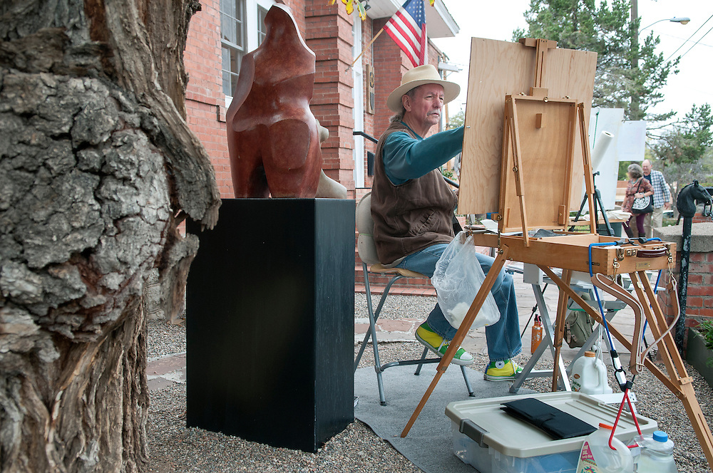 Frank Balaam, from Arizona, works on a painting outside the Ventana Fine Arts gallery in Santa Fe, Friday, Oct. 17, 2014. They are taking part in the 7th annual Canyon Road Paint Out and Sculpt Out. The event will also be held Saturday from 10am to 3pm with dozens of artist demonstrating their art. There will be a parade at 12, SFPS student performance at 1 and 2, and a flash mob at 3. (Eddie Moore/Albuquerque Journal)