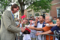 COOPERSTOWN, NY - JULY 25: Hall of Fame Inductee Randy Johnson signs autographs for fans during the Parade of Legends down Main Street on July 25, 2015 in Cooperstown, NY. (Photo by Jennifer Stewart/Arizona Diamondbacks/Getty Images)