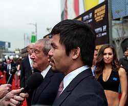 LOS ANGELES, CA - MAR 10 Manny Pacquiao arrives at the red carpet before the Mayweather vs Pacquiao press conference at the Nokia Theater in Los Angeles, California USA to promote their upcoming bout at the MGM Grand in Las Vegas, NV May 2, 2015. This is the ony presser. 2015 Feb 9. Byline, credit, TV usage, web usage or linkback must read SILVEXPHOTO.COM. Failure to byline correctly will incur double the agreed fee. Tel: +1 714 504 6870.