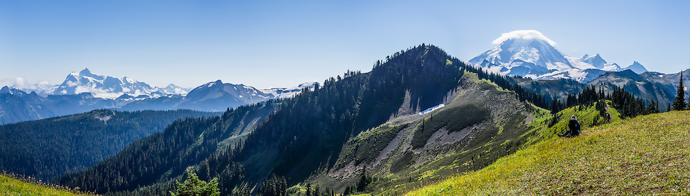 Along the Skyline Divide trail in Mount Baker Wilderness (in Mount Baker-Snoqualmie National Forest), admire a panorama from Mount Shuksan to Mount Baker (10,781 feet, on right) in the State of Washington, USA. This panorama was stitched from 7 overlapping photos.