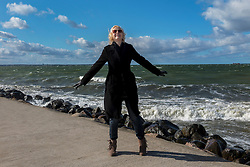 Woman standing on Merivälja pier in Tallinn.