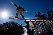 A snowboarder hits a rail at the Art Park on Mammoth Mountain, Calif., January 28, 2011.