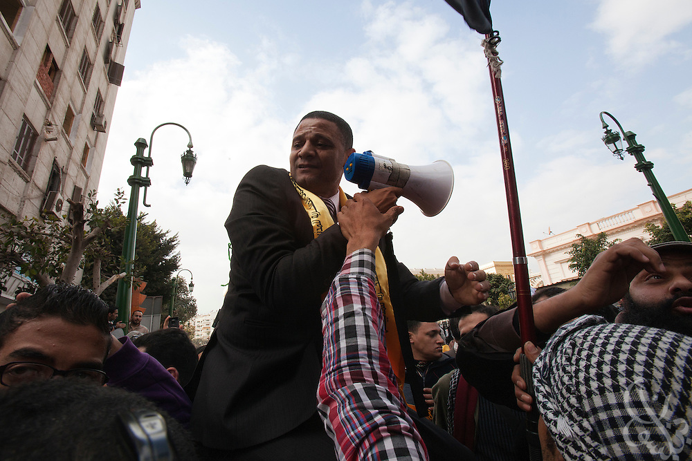 Egyptian Parliamentarian Khalid Shabani tries to calm protesters outside the parliament complex during the historic first session of Egypt's newly elected Parliament Jan 23, 2012 in Cairo, Egypt.