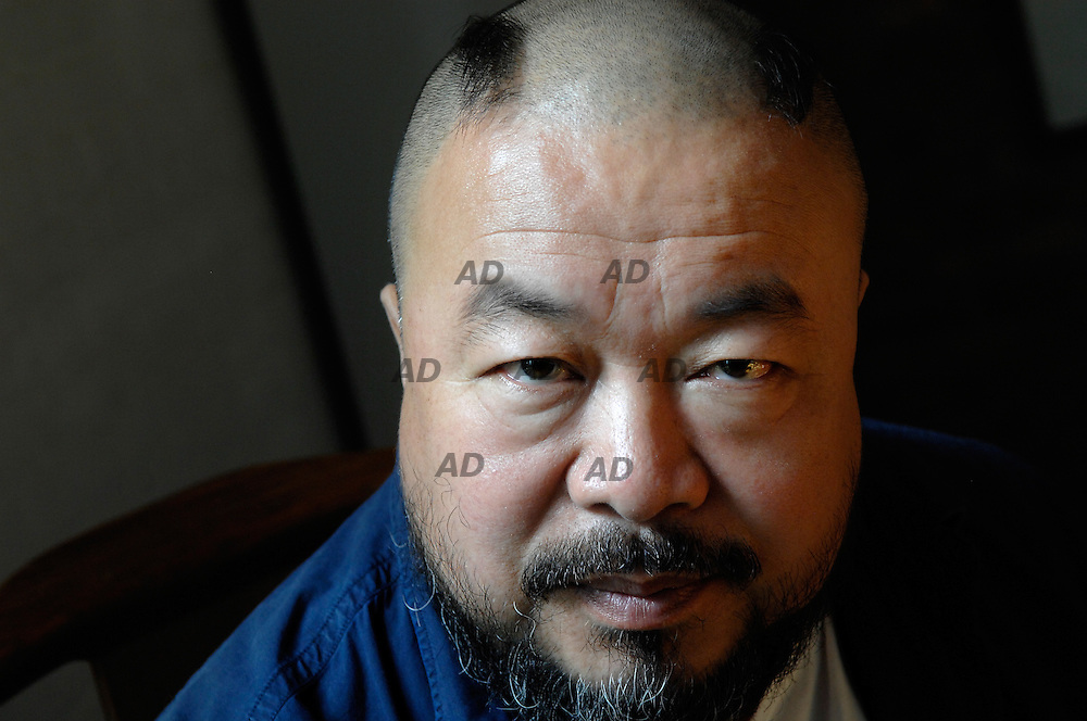 The Chinese artist Ai Weiwei.<br /> Thanks to his work with the Swiss firm Herzog &amp; de Meuron on the Olympic stadium being built here for the 2008 Summer Games, he suddenly finds himself with a rising profile in the architecture world.<br /> Mr. Ai's father, Ai Qing, was perhaps the best-known poet of his generation, and among the most acclaimed Chinese literary figures of the 20th century. But he was caught up in a purge of intellectuals that began in 1957. In 1958, when Ai Weiwei was a year old, the government sent the family away from Beijing in the Gobi Desert, beginning a forced exile from the capital that would last nearly 20 years. Then he enrolled in the Beijing Film Institute and at the same time he began making art and trying to get it shown, and he fell in with the Stars Group, made up of artists and writers, which the government tried to suppress in the late 1970's.<br /> Ai fly to New York in 1981, where he studied briefly at the Parsons School of Design and the Art Students League before settling in the East Village to try to make a living as a conceptual artist. In 1993, after Mr. Ai had been in New York more than 10 years, he moved back. Mr. Ai was able to restore the family name to a measure of prominence while still producing sharply political artwork. His house is filled with a mixture of furniture that Mr. Ai designed &Ntilde; some of it straddling the line between functional and whimsical &Ntilde; and traditional Chinese pieces. Just off the dining area is a spacious studio that on a recent visit was nearly filled with an installation of large wooden columns that Mr. Ai salvaged from a 100-year-old temple destroyed in southern China. He said the installation was in part a commentary on the Chinese government's continued destruction of traditional architecture in cities like Shanghai and Beijing to make way for new office towers and residential developments. In 2000 Mr. Ai designed a headquarters for the China Art Archives and Warehouse.