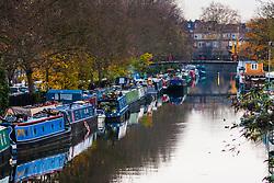 Paddington Basin, London, November 25th 2014. Smoke rises from a chimney on a canal boat on the Grand Union Canal near Paddington.