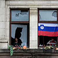 Pro Russian sympathizers light candles and lay flower on a window of the  burned-out trade union building in Odessa.