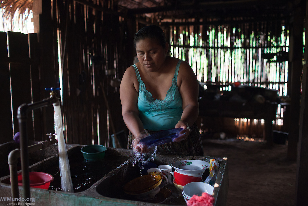 Rosa Elbira Coc Ich, resident of Lote 8 community and one of the eleven plaintiffs in the Caal vs. HudBay legal case in Canada, washes the dishes at her parents' home. The Q'eqchi' Mayan community of Lote 8 was violently evicted on January 17, 2007, by State forces at the orders of the Guatemalan Nickel Company (CGN), then-owned by Canadian mining firm Skye Resources. During the eviction, numerous local women were gang-raped by Police officers and CGN security personnel. In a landmark legal case, eleven women from Lote 8 are suing HudBay Minerals Inc., the mining firm that purchased Skye in 2008, in the home jurisdiction of Ontario, Canada, for negligence and carelessness causing physical and psychological harm. Cahaboncito, Panzos, Alta Verapaz, Guatemala. May 10, 2016.