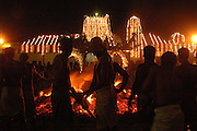 Sri Lanka. Udappuwa festival, the preparation for the fire walking. The pit is prepared. The burning wood levelled, the embers shaped into a rectangular pit.