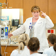 Professor Kaye Slater teaches BSN students in our Sim Lab. (Photo by Rajah Bose)