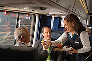 passengers on a train enjoying the train experience