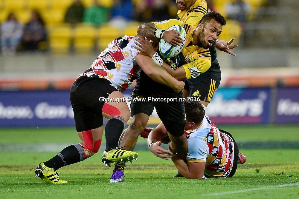 Willis Halaholo (C of the Hurricanes is tackled by Stefan Willemse (L) and Jacobie Adriaanse of the Southern Kings during the Hurricanes vs Kings Super Rugby  match at the Westpac Stadium in Wellington on Friday the 25th of March 2016. Copyright Photo by Marty Melville / www.Photosport.nz