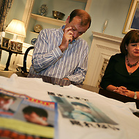 Bill and Julia Hawker, parents of murdered UK national Lindsay Hawker, photographed in the British Ambassadors residence in Tokyo, Japan, on Friday 29th  June 2007.  LIndsay Hawker was murdered, and the suspect Tatsuya Ichihashi is still on the run, wanted by the police in connection with the murder. On the table, in the photo, are a wanted poster for Ichihashi and also a t-shirt bearing his image.