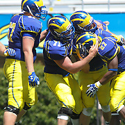 Delaware Running Back Julian Laing (27) celebrates with his teammates in the end zone in the second half of Delaware's Annual Spring football game Saturday May. 04, 2013 at Delaware Stadium in Newark Delaware...Delaware will open it home schedule against Jacksonville University Aug. 29, 2013 at 7:30 p.m