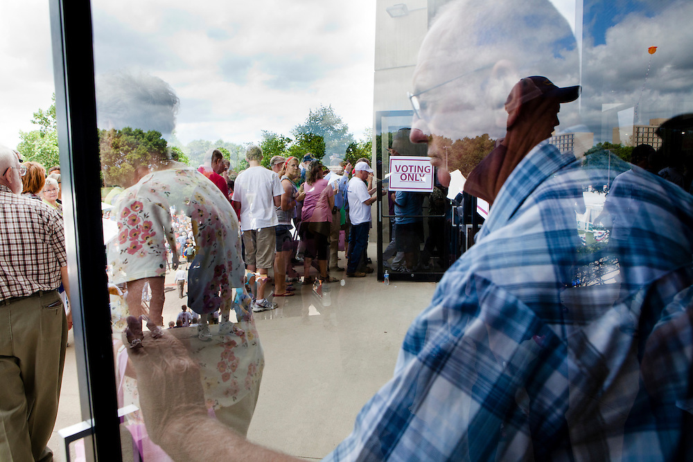 People enter the Hilton Coliseum to participate in the Iowa Republican Straw Poll on Saturday, August 13, 2011 in Ames, IA.