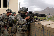 Soldiers of the 3rd platoon of the 10th mountain division during a fire fight with the taleban in the district center of Sharc in Logar province, Afghanistan on Thursday, May 7th 2009...Photo: Guilad Kahn.