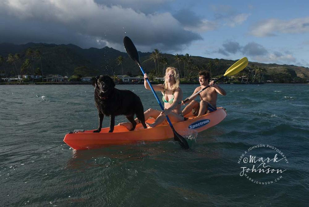 Couple & dog on kayak, Oahu, Hawaii