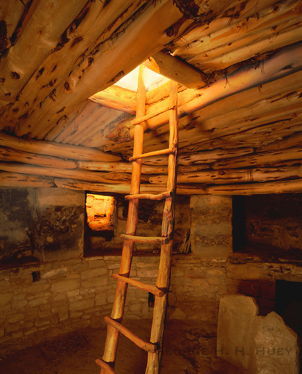 0405-1080 ~ Copyright: George H. H. Huey ~ Kiva at Spruce Tree House, with ladder and reconstructed ceiling. Anasazi Culture. .Occupied 12th/13th century. Mesa Verde National Park, Colorado.