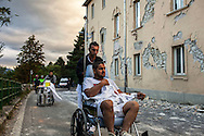24 August 2016, Amatrice Italy - An injured man is carried on a wheelchair outside the hospital after a 6.3 earthquake hit the town of Amatrice in Lazio region killing more than 240 people. Many other towns of the italian central regions have been hit by the quake. There are still many missing people under the rubble.